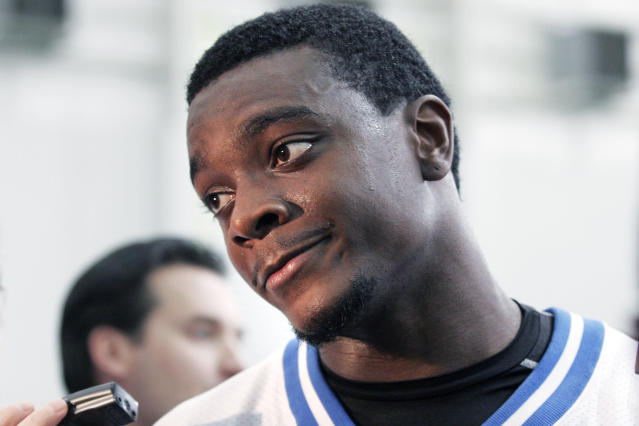 FILE - In this Nov. 2, 2005, file photo, Detroit Lions wide receiver Charles Rogers listens to a reporter's question after working out in Allen Park, Mich. Former Michigan State University star and Lions' Rogers has died. A woman who identified herself as Cathy Rogers, his mother, confirmed the death Monday, Nov. 11, 2019, in a phone call from The Associated Press. (AP Photo/Duane Burleson, File)
