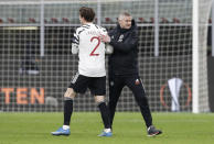 Manchester United's manager Ole Gunnar Solskjae, right, congratulates Victor Lindelof following the Europa League round of 16 second leg soccer match between AC Milan and Manchester United at the San Siro Stadium, in Milan, Italy, Thursday, March 18, 2021. (AP Photo/Antonio Calanni)