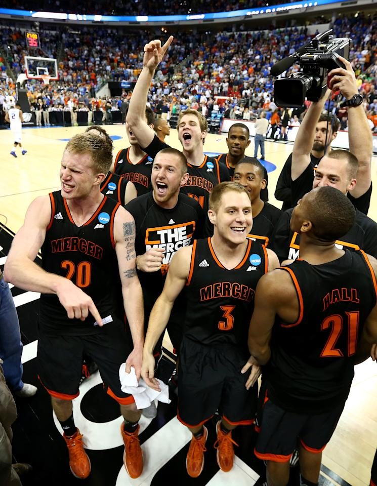 RALEIGH, NC - MARCH 21: Kevin Canevari #3 of the Mercer Bears celebrates with teammates after defeating the Duke Blue Devils 78-71 during the Second Round of the 2014 NCAA Basketball Tournament at PNC Arena on March 21, 2014 in Raleigh, North Carolina. (Photo by Streeter Lecka/Getty Images)