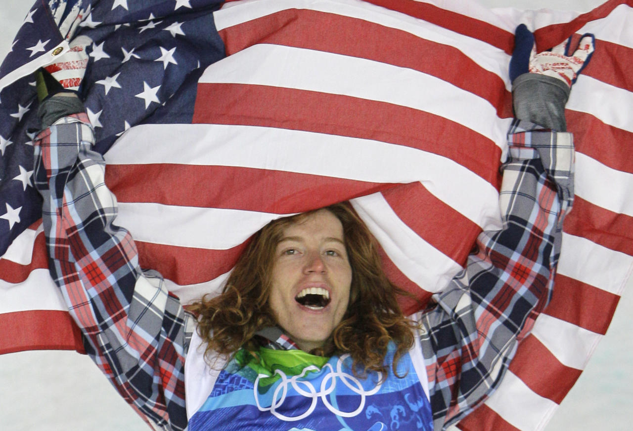 Olympic champion Shaun White of the USA celebrate after the men's snowboard halfpipe final at the Vancouver 2010 Olympics in Vancouver, British Columbia, Wednesday, Feb. 17, 2010. (AP Photo/Gerry Broome)