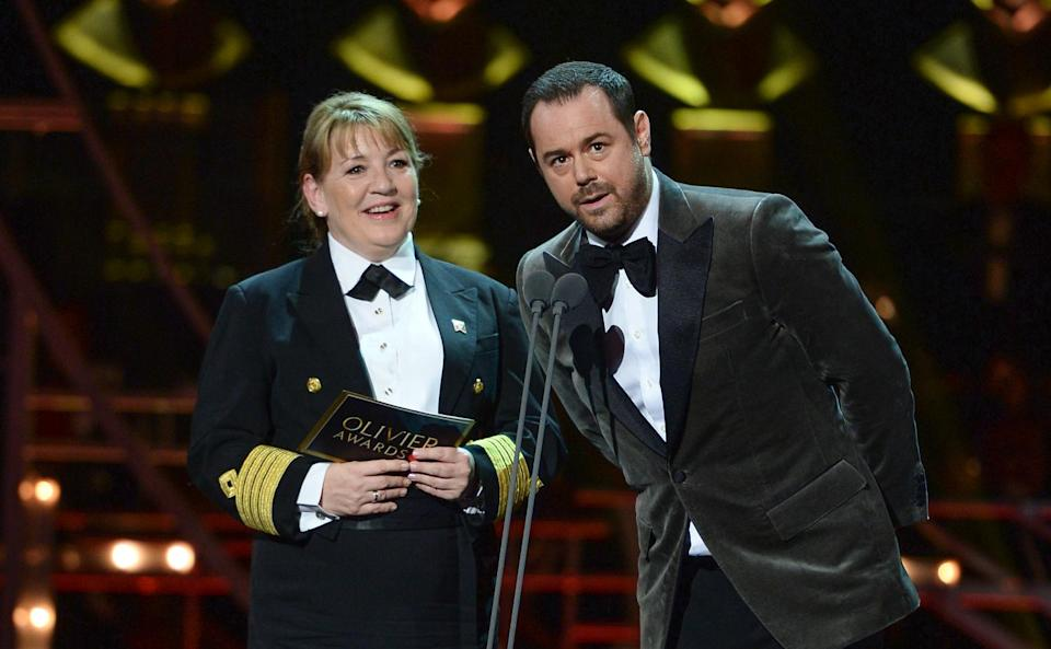 Danny Dyer (R) and Cunard Captain Inger Klein Thorhauge on stage during The Olivier Awards 2019 with Mastercard at the Royal Albert Hall on April 07, 2019 in London, England. (Photo by Jeff Spicer/Getty Images)