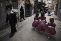 Ultra-Orthodox Jewish girls wear costumes to celebrate the Jewish holiday of Purim in Jerusalem, Sunday, Feb. 28, 2021. The Jewish holiday of Purim commemorates the Jews' salvation from genocide in ancient Persia, as recounted in the biblical Book of Esther. (AP Photo/Oded Balilty)
