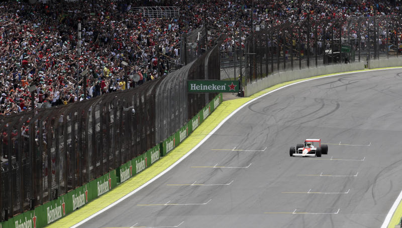 Ayrton Senna's nephew, Bruno, drives an original 1988 McLaren car prior to the Brazilian Formula One Grand Prix at the Interlagos race track in Sao Paulo, Brazil, Sunday, Nov. 17, 2019. (AP Photo/Silvia Izquierdo)