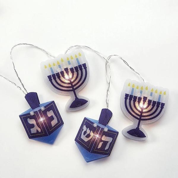 "<p>moderntribe.com</p><p><strong>$15.99</strong></p><p><a href=""https://moderntribe.com/products/hanukkah-hologram-light-set?variant=29505099563069¤cy=USD&gclid=CjwKCAjw-5v7BRAmEiwAJ3DpuGHo_GLTzOmkqitp4VDT-vZrFqv8fD0gRJtUiCMtNm4-iOO4Xe44YhoCbx0QAvD_BwE"" rel=""nofollow noopener"" target=""_blank"" data-ylk=""slk:Shop Now"" class=""link rapid-noclick-resp"">Shop Now</a></p><p>Brighten doorways, windows, and more with this festive set of Hanukkah string lights. No plugs are required, since the set is battery-powered, which makes installing them a breeze.</p>"