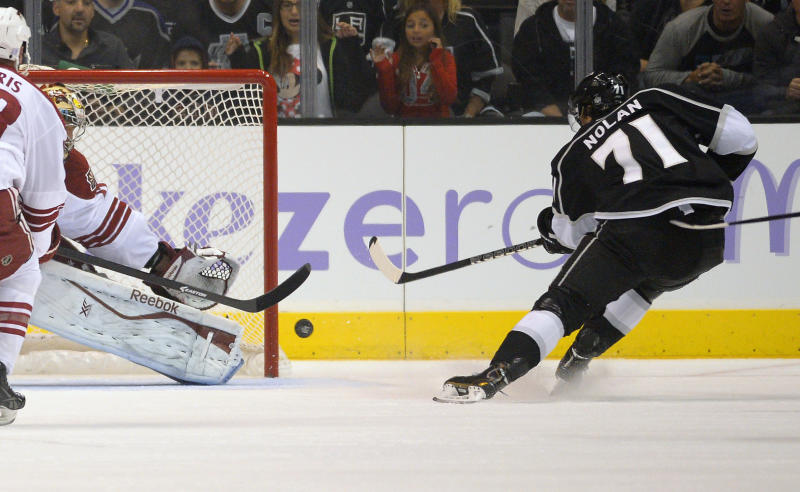 Los Angeles Kings center Jordan Nolan, right, scores against Phoenix Coyotes goalie Mike Smith during the first period of their NHL hockey game on Thursday, Oct. 24, 2013, in Los Angeles. (AP Photo/Mark J. Terrill)