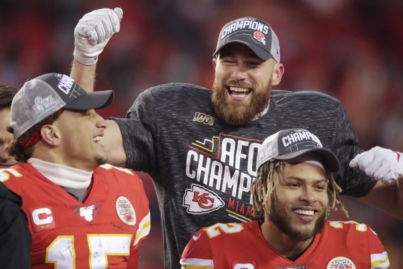 Kansas City Chiefs' Travis Kelce Patrick Mahomes and Tyrann Mathieu celebrate after the NFL AFC Championship football game against the Tennessee Titans Sunday, Jan. 19, 2020, in Kansas City, MO. The Chiefs won 35-24 to advance to Super Bowl 54. (AP Photo/Charlie Riedel)