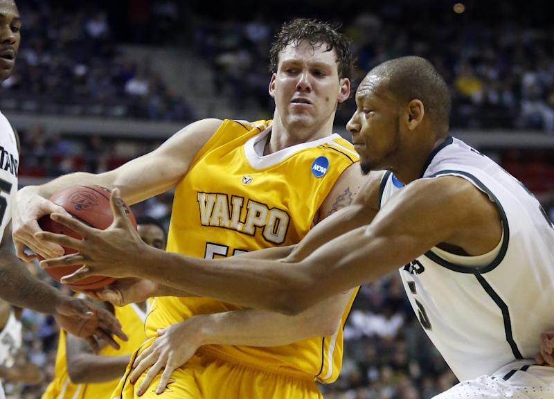 Valparaiso forward Kevin Van Wijk, left, steals the ball from Michigan State forward Adreian Payne, right, in the first half of a second-round game of the NCAA college basketball tournament Thursday, March 21, 2013, in Auburn Hills, Mich. (AP Photo/Duane Burleson)