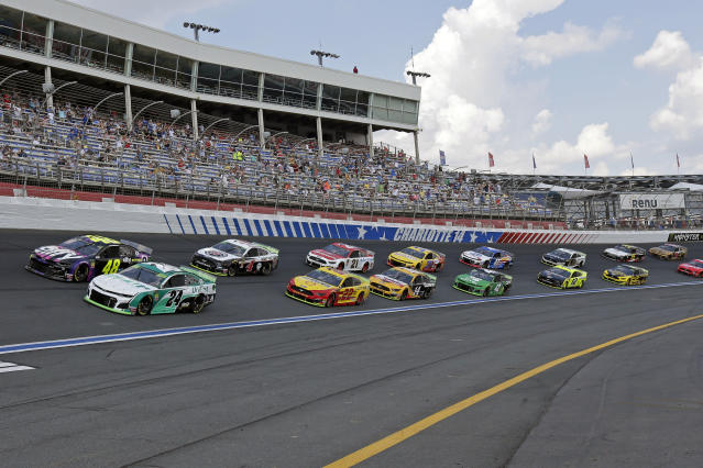 William Byron (24) and Jimmie Johnson (48) lead the field of cars through Turn 4 to start a NASCAR Cup Series auto race at Charlotte Motor Speedway in Concord, N.C., Sunday, Sept. 29, 2019. (AP Photo/Gerry Broome)