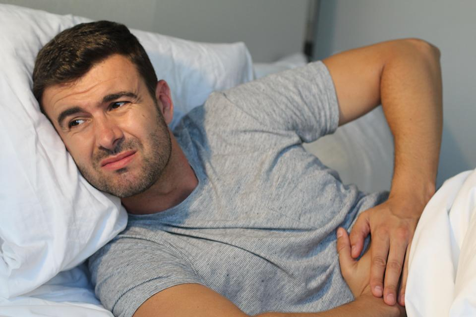 Man with stomach pain suffering.