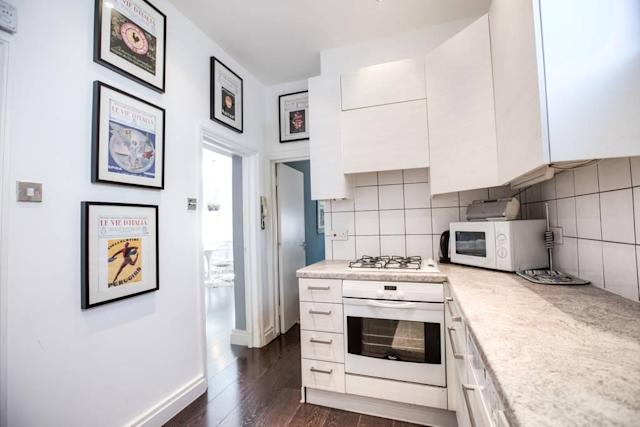 <p>The kitchen is a clean, stark white and is equipped with modern appliances. Fancy a cuppa, anyone?<br>(Airbnb) </p>