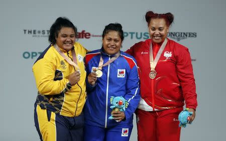 Weightlifting - Gold Coast 2018 Commonwealth Games - Women's +90kg - Final - Carrara Sports Arena 1 - Gold Coast, Australia - April 9, 2018. Gold medalist Feagaiga Stowers of Samoa, silver medalist Charisma Amoe-Tarrant of Nauru and bronze medalist Emily Campbell of England. REUTERS/Paul Childs