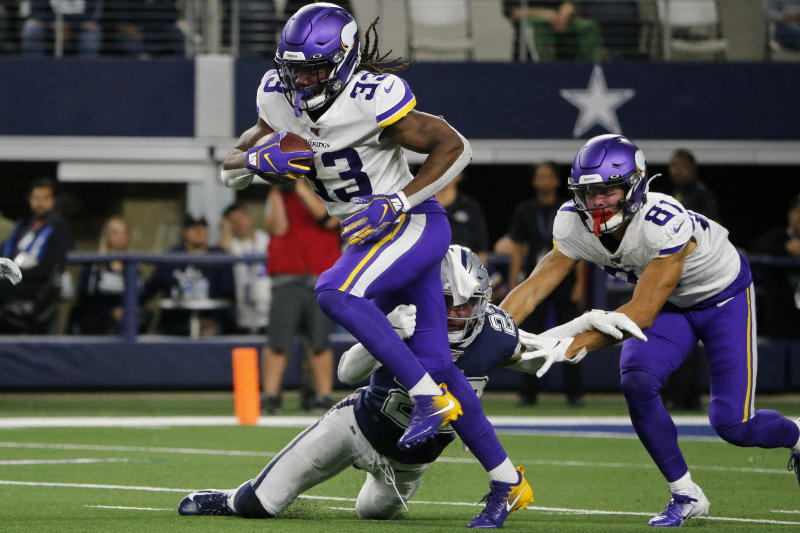 Minnesota Vikings running back Dalvin Cook (33) struggles for extra yardage as Bisi Johnson (81) helps against a tackle attempt by Dallas Cowboys' Darian Thompson (23) during the first half of an NFL football game in Arlington, Texas, Sunday, Nov. 10, 2019. (AP Photo/Michael Ainsworth)
