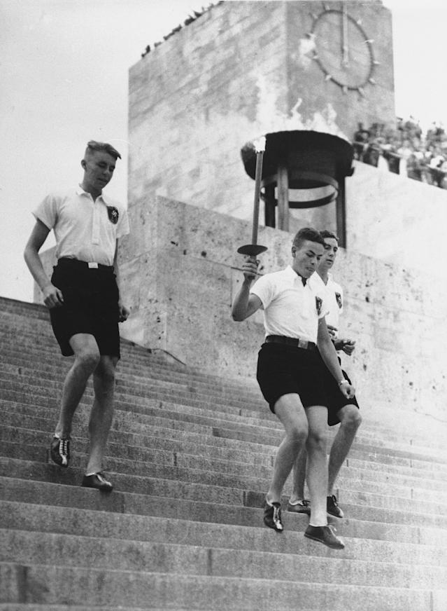 The Olympic flame is brought from the Berlin stadium to Gruenau, Aug. 1, 1936. (AP Photo)