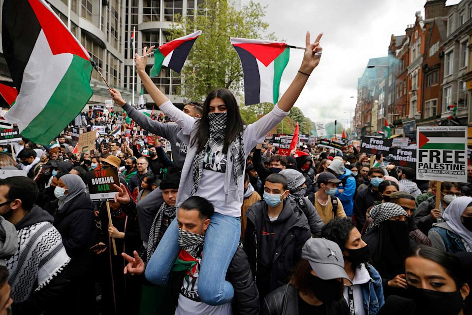 <p>Thousands of protesters took to the streets on Saturday </p> (AFP via Getty Images)