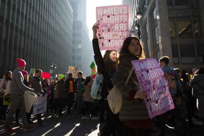 <p>Demonstrators across Madison Avenue during a women's march, Saturday, Jan. 21, 2017, in New York. The march is being held in solidarity with similar events taking place in Washington and around the nation. (AP Photo/Mary Altaffer) </p>