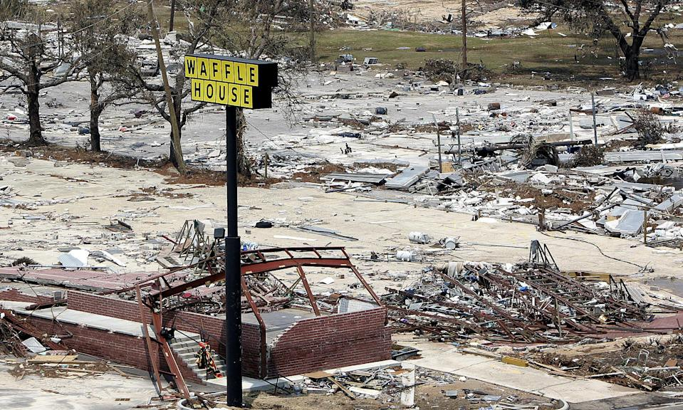 A sign is all that's left of this Waffle House on the beach in Gulfport, Miss., Wednesday, Aug. 31, 2005. (AP Photo/Phil Coale)