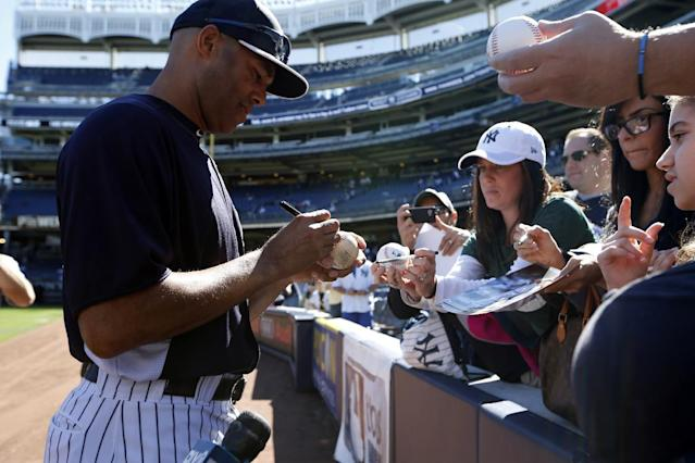 New York Yankees relief pitcher Mariano River signs autographs before being honored in a retirement ceremony at Yankee Stadium ahead of their baseball game against the San Francisco Giants, Sunday, Sept. 22, 2013, in New York. (AP Photo/Kathy Willens)