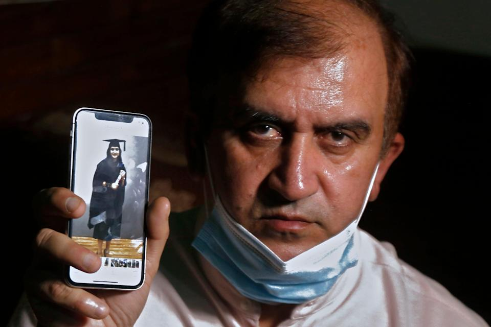 File image: An image of Mayra Zulfiqar, a British woman of Pakistani origin who was found dead at a home, is displayed by her father Muhammad Zulfiqar on his mobile phone in Lahore, Pakistan, on 20 May, 2021 (AP)