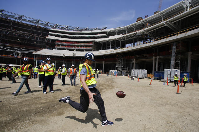Los Angeles Rams punter Johnny Hekker kicks the ball while visiting the team's new NFL football stadium Thursday, June 14, 2018, in Inglewood, Calif. Coach Sean McVay scrapped the final practice of minicamp and took his players and coaches on a tour of their multibillion-dollar stadium, which will open for the 2020 season. (AP Photo/Jae C. Hong)
