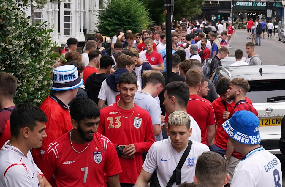 England fans queuing outside the The Faltering Fullback pub in Finsbury Park, London (PA Wire)