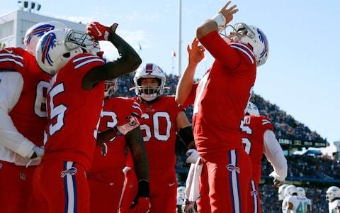 Buffalo Bills quarterback Josh Allen, right, celebrates his touchdown pass to wide receiver John Brown, left, in the second half of an NFL football game Miami Dolphins, Sunday, Oct. 20, 2019, in Orchard Park, N.Y - Credit: AP
