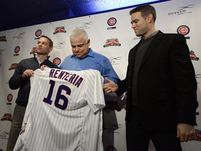 Chicago Cubs new manager Rick Renteria, center, receives a jersey from Cubs president of baseball operations Theo Epstein, right, and Cubs vice president and general manager Jed Hoyer left, during a baseball press conference at Wrigley Field in Chicago, Thursday, Dec., 5, 2013. Renteria met with the media for the first time since he was hired last month, while recuperating in San Diego from hip surgery. (AP Photo/Paul Beaty)