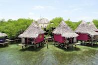"""<h3><strong><a rel=""""nofollow noopener"""" href=""""https://www.airbnb.com/rooms/1169590"""" target=""""_blank"""" data-ylk=""""slk:Urraca Island, Panama"""" class=""""link rapid-noclick-resp"""">Urraca Island, Panama</a></strong></h3> <p>While private island vacays might seem like they're reserved for the ultra-wealthy, that's not always the case. At this Bocas Del Toro mangrove island paradise, you—and all your friends—can escape in overwater bungalows for less than $200 a night (total!). The island is a true getaway, surrounded by nature (you'll share the island with adorable monkeys) and the pristine water. Included with the island are four overwater bungalows with outdoor showers, a family bungalow which sleeps six, a dining area, natural swimming pool, and two kayaks for exploring the surrounding atolls. <i>Rates from $195 per night. </i></p>"""