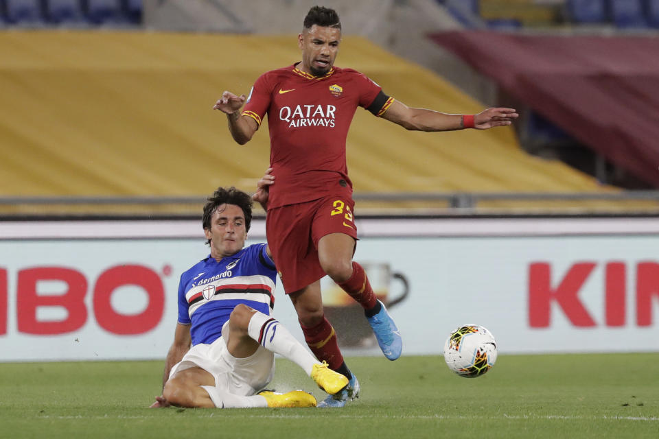 Roma's Bruno Peres vies for the ball with Sampdoria's Tommaso Augello during a Serie A soccer match between Roma and Sampdoria, at Rome's Olympic Stadium, Wednesday, June 24, 2005. (AP Photo/Andrew Medichini)
