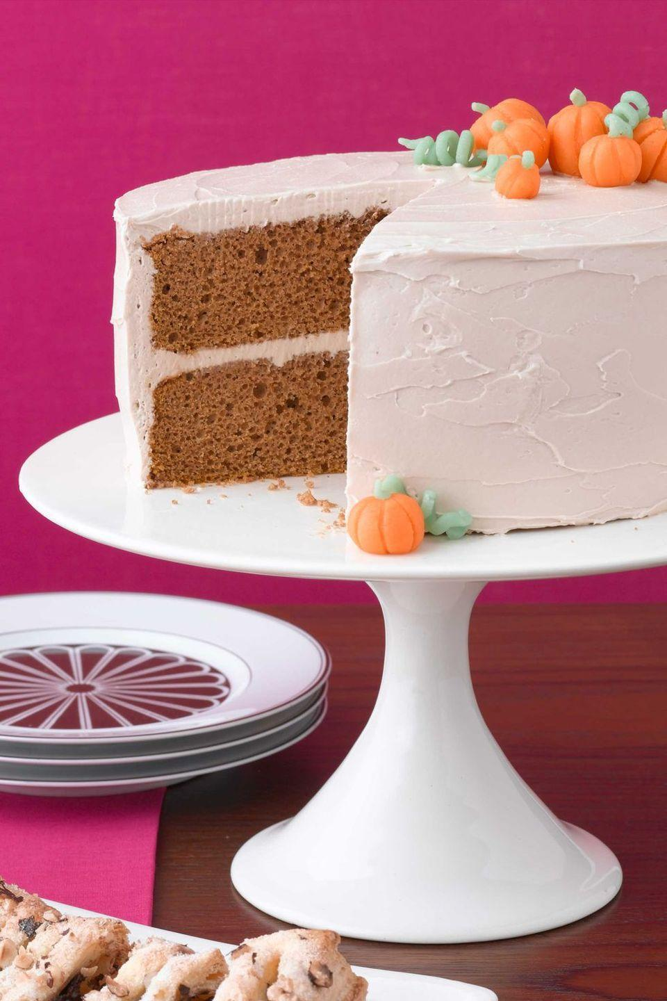 "<p>Guests will love cutting into this simple, yet delicious <a href=""https://www.womansday.com/food-recipes/food-drinks/g2498/pumpkin-cakes/"" rel=""nofollow noopener"" target=""_blank"" data-ylk=""slk:pumpkin spice cake"" class=""link rapid-noclick-resp"">pumpkin spice cake</a>. The marshmallow cream and maple extract frosting take it over the top, while pumpkin candy garnishes add a festive touch. </p><p><strong><em><a href=""https://www.womansday.com/food-recipes/food-drinks/recipes/a10565/pumpkin-spice-cake-121554/"" rel=""nofollow noopener"" target=""_blank"" data-ylk=""slk:Get the Pumpkin Spice Cake recipe."" class=""link rapid-noclick-resp"">Get the Pumpkin Spice Cake recipe. </a></em></strong></p>"