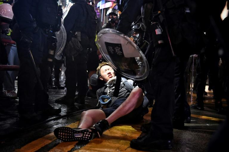 Police detain a protester at Causeway Bay in Hong Kong late on August 31, 2019