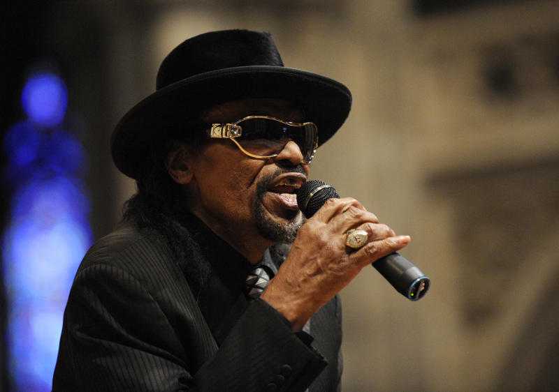 """FILE - In this Jan. 18, 2010 file photo, master of ceremonies Chuck Brown speaks during a program to celebrate the legacy of the late Martin Luther King, Jr. at the Washington National Cathedral in Washington. Brown, who styled a unique brand of funk music as a singer, guitarist and songwriter known as the """"godfather of go-go,"""" died Wednesday, May 16, 2012 after suffering from pneumonia. He was 75. (AP Photo/Nick Wass, File)"""