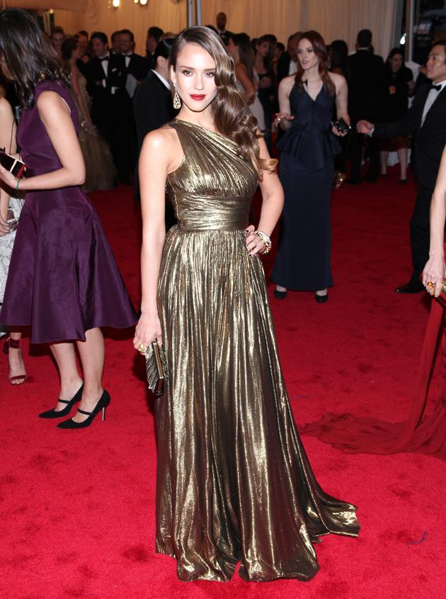 Jessica Alba also wore the metallic trend in an asymmetric Michael Kors gown / WENN