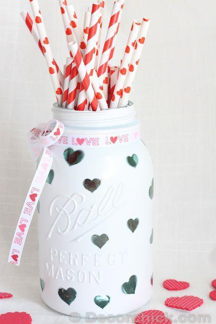 """<p>Small heart stickers and glossy white paint are all you need to turn a jar into an adorable pencil holder or vase (perfect for teachers!).</p><p><strong>Get the tutorial at <a href=""""http://decorchick.com/valentine-crafts/"""" rel=""""nofollow noopener"""" target=""""_blank"""" data-ylk=""""slk:Decor Chick"""" class=""""link rapid-noclick-resp"""">Decor Chick</a>.</strong></p><p><a class=""""link rapid-noclick-resp"""" href=""""https://www.amazon.com/Just-Artifacts-Decorative-Birthday-Celebrations/dp/B01M647765/ref=sr_1_4_sspa?tag=syn-yahoo-20&ascsubtag=%5Bartid%7C10050.g.93%5Bsrc%7Cyahoo-us"""" rel=""""nofollow noopener"""" target=""""_blank"""" data-ylk=""""slk:SHOP STRAWS"""">SHOP STRAWS</a></p><p><strong>RELATED: </strong><a href=""""https://www.countryliving.com/shopping/gifts/g1416/valentines-day-gifts/"""" rel=""""nofollow noopener"""" target=""""_blank"""" data-ylk=""""slk:The Ultimate Valentine's Day Gift Guide"""" class=""""link rapid-noclick-resp""""><strong>The Ultimate Valentine's Day Gift Guide</strong></a></p>"""