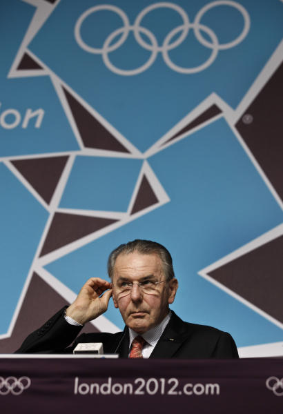 International Olympic Committee (IOC) President Jacques Rogges listens to a reporter's question at a press conference at the 2012 Summer Olympics, Saturday, July 21, 2012, in London. (AP Photo/Ben Curtis)