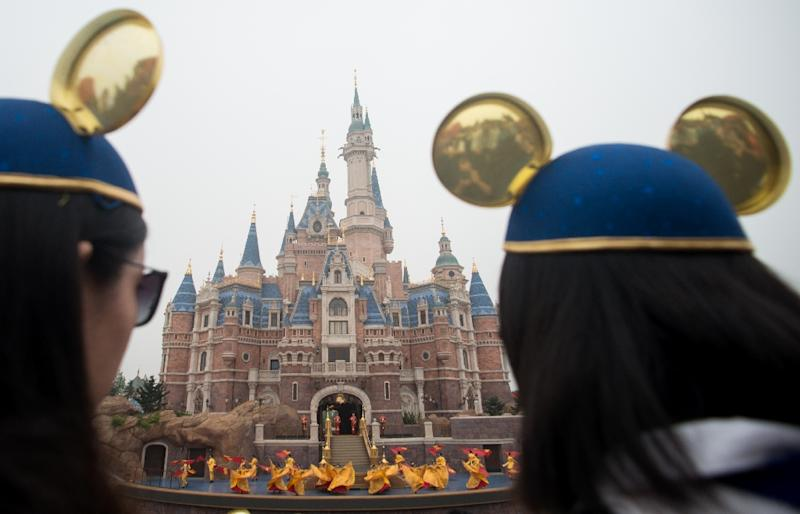 Women wearing Mickey Mouse ears last year at China's Shanghai Disney Resort where turkey legs slathered in hoisin sauce have become a surprise favorite menu item (AFP Photo/JOHANNES EISELE)