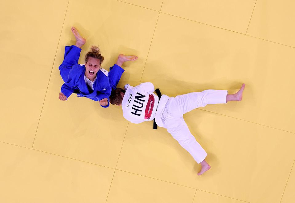 <p>Odette Giuffrida of Italy celebrates after defeating Reka Pupp of Hungary during the July 25 women's Judo contest for bronze. </p>