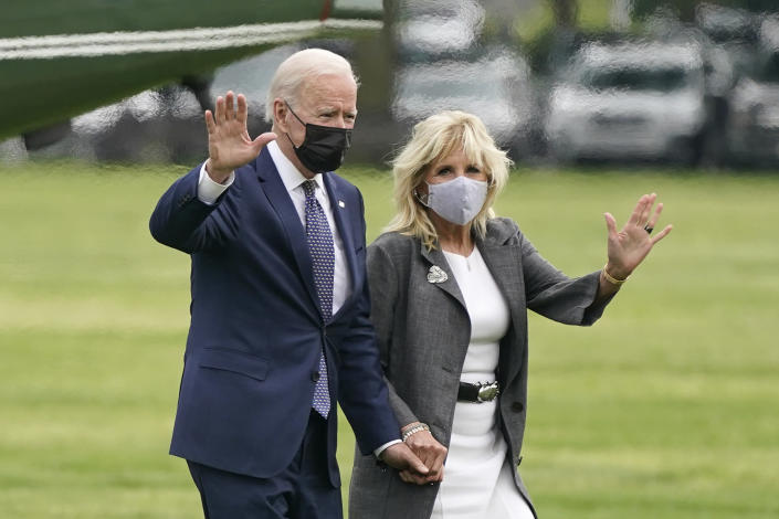 President Joe Biden and first lady Jill Biden wave after stepping off Marine One on the Ellipse near the White House, Monday, May 3, 2021, in Washington. The Biden's traveled Monday to coastal Virginia to promote his plans to increase spending on education and children, part of his $1.8 trillion families proposal announced last week. (AP Photo/Patrick Semansky)