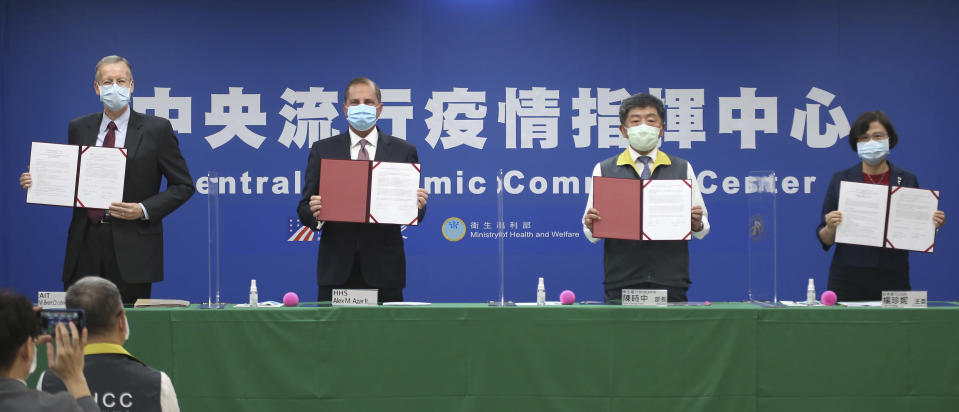 From left; Director of the American Institute in Taiwan (AIT) William Brent Christensen, U.S. Health and Human Services Secretary Alex Azar, Taiwanese Minister of Health and Welfare Chen Shih-chung and Director-General of Bureau of Foreign Trade Yang Jen-ni pose for a photo during a signing ceremony for a memorandum of understanding at the Central Epidemic Command Center in Taipei, Taiwan, Monday, Aug. 10, 2020. Azar arrived in Taiwan on Sunday in the highest-level visit by an American Cabinet official since the break in formal diplomatic relations between Washington and Taipei in 1979. (AP Photo/Chiang Ying-ying)
