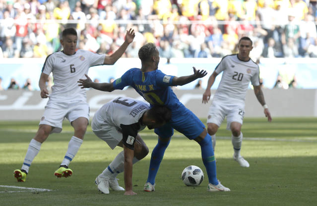 Brazil's Neymar flops in the penalty area against Costa Rica. (AP Photo/Petr David Josek)