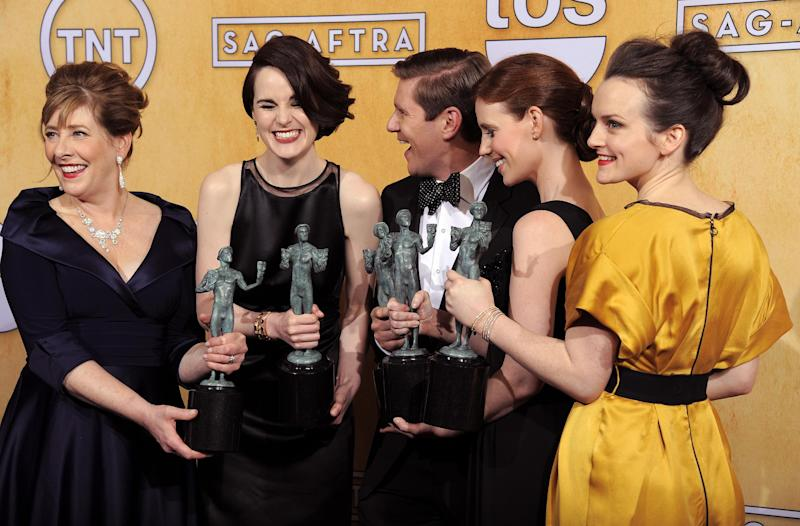 """Actors, from left, Phyllis Logan, Michelle Dockery, Allen Leech, Amy Nuttall and Sophie McShera pose backstage with the award for best ensemble in a drama series for """"Downton Abbey"""" at the 19th Annual Screen Actors Guild Awards at the Shrine Auditorium in Los Angeles on Sunday Jan. 27, 2013. (Photo by Chris Pizzello/Invision/AP)"""