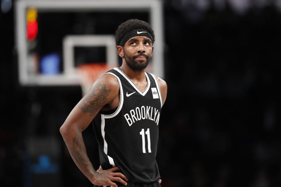 Brooklyn Nets guard Kyrie Irving (11) reacts during the first half of the team's NBA basketball game against the Indiana Pacers, Wednesday, Oct. 30, 2019, in New York. The Pacers won 118-108. (AP Photo/Kathy Willens)