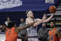 Gonzaga forward Drew Timme shoots while pressured by Pacific forward Jordan Bell, left, during the first half of an NCAA college basketball game in Spokane, Wash., Saturday, Jan. 23, 2021. (AP Photo/Young Kwak)
