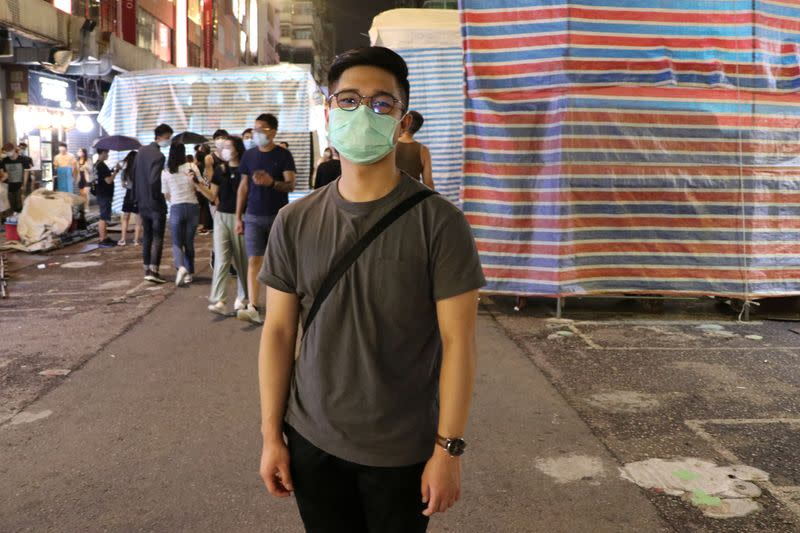 Lui, 22, poses for a photo after an interview with Reuters at Mong Kok, in Hong Kong
