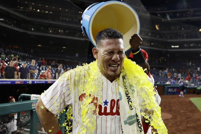 Philadelphia Phillies' Wilson Ramos is doused by Odubel Herrera after the Phillies' 7-4 win in a baseball game against the Boston Red Sox, Wednesday, Aug. 15, 2018, in Philadelphia. (AP Photo/Matt Slocum)