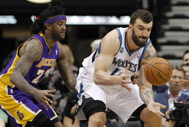 Minnesota Timberwolves center Nikola Pekovic, right, of Montenegro, regains control of the ball in front of Los Angeles Lakers forward Jordan Hill (27) during the second quarter of an NBA basketball game in Minneapolis, Friday, March 28, 2014. (AP Photo/Ann Heisenfelt)