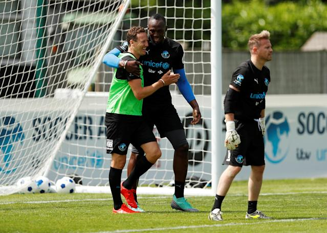 Soccer Football - England & Soccer Aid World XI Training - Motspur Park, London, Britain - June 8, 2018 Soccer Aid World XI's Usain Bolt and Brendan Cole during training Action Images via Reuters/Andrew Boyers