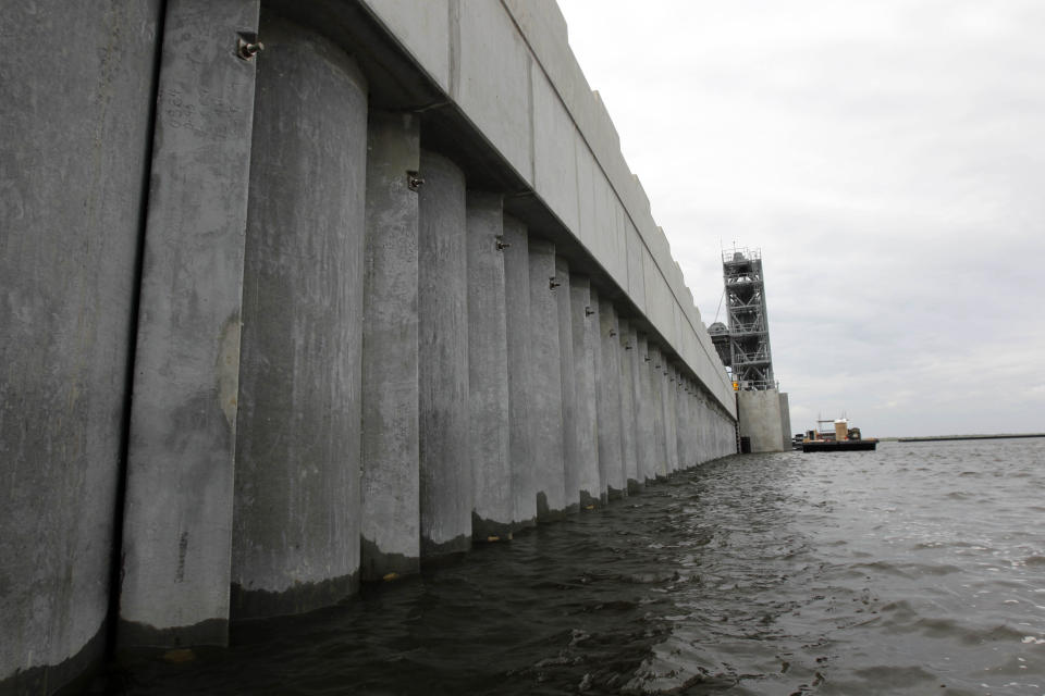 FILE - In this June 22, 2012 file photo, the Inner Harbor Navigation Canal (IHNC) Surge Barrier, constructed after Hurricane Katrina to prevent tidal surges from hurricanes from reaching New Orleans, is seen in St. Bernard Parish, La. New Orleans finds itself in the path of Hurricane Ida 16 years to the day after floodwalls collapsed and levees were overtopped by a storm surge driven by Hurricane Katrina. The federal government spent $14.5 billion on levees, pumps, seawalls, floodgates and drainage that provides enhanced protection from storm surge and flooding in New Orleans and surrounding suburbs south of Lake Pontchartrain. With the exception of three drainage projects, that work is complete (AP Photo/Gerald Herbert, File)