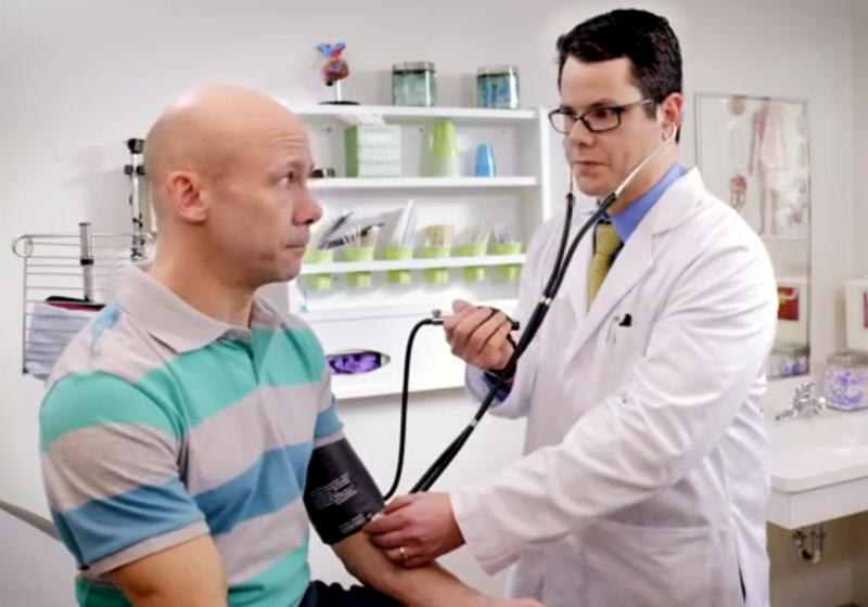 In this image from video provided by Wellmark Blue Cross and Blue Shield, a blood pressure cuff lets out a strange noise when the doctor takes a patient's blood pressure in an ad from the Midwestern insurer. Wellmark launched ads recently in Iowa and South Dakota poking fun at technical problems that have plagued the federal government's insurance enrollment website while trying to lure away some potential customers. (AP Photo/Wellmark Blue Cross and Blue Shield)