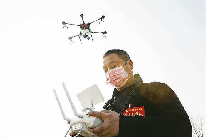 Coronavirus outbreak,COVID-19 pandemic, china,AI-powered, drones,technologies,Remote communication,UVD Robots,air purifiers,Shenzhen MicroMultiCopter