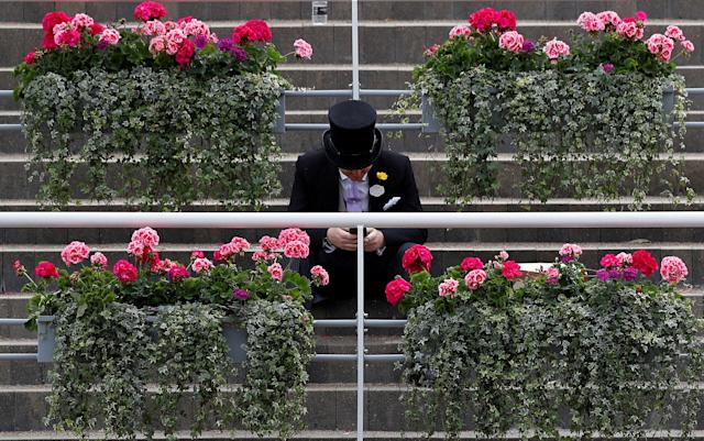 Horse Racing - Royal Ascot - Ascot Racecourse, Ascot, Britain - June 23, 2018 Racegoer in the stands at Ascot Racecourse REUTERS/Peter Nicholls TPX IMAGES OF THE DAY
